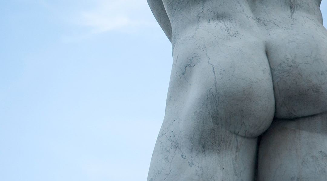 A marble statue of a male's buttocks