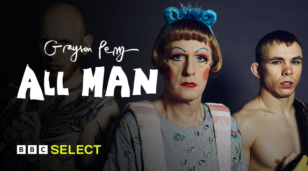 Grayson Perry stands between two men