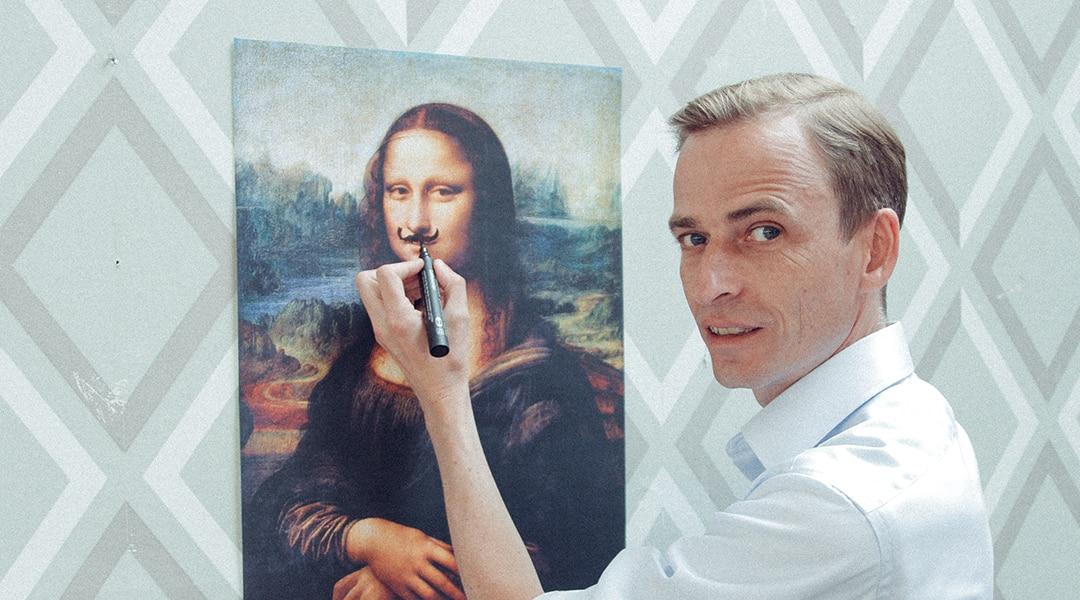 Man drawing moustache on Mona Lisa
