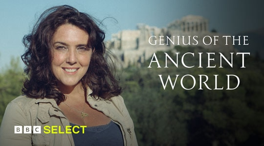 Bettany Hughes stands in front of ancient ruins