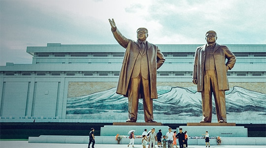 Statues of bronze monument to Kim Il-sung and Kim Jong-il in North Korea