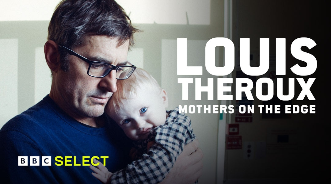 Louis Theroux carrying a baby