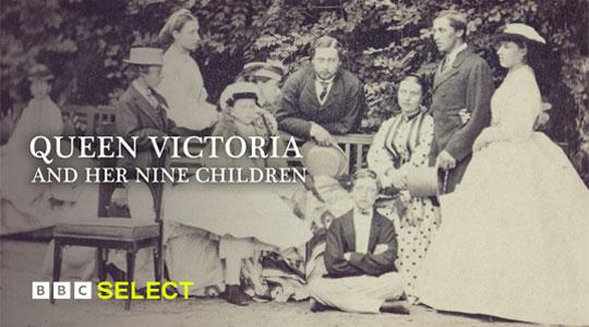 Queen Victoria sits amongst her children